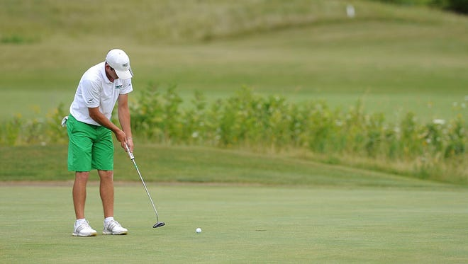 Joe DuChateau, of Fond du Lac, putts on the green during the second day of the Fond du Lac County Amateur at Rolling Meadows Golf Course on Sunday afternoon.