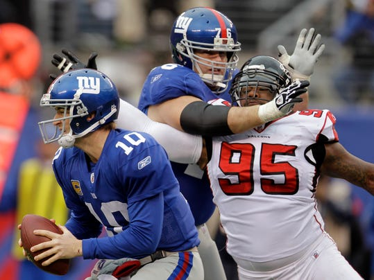 FILE - In this Jan. 8, 2012 file photo, New York Giants guard Chris Snee (76) stops Atlanta Falcons defensive tackle Jonathan Babineaux (95) from reaching Eli Manning during the first half of an NFL wild card playoff football game in East Rutherford, N.J. Snee, the 32-year-old son-in-law of coach Tom Coughlin, is retiring from the Giants because of a series of injuries. Snee met with the team Monday, July 21, 2014, then decided to end his NFL career after 10 seasons. (AP Photo/Julio Cortez, File)