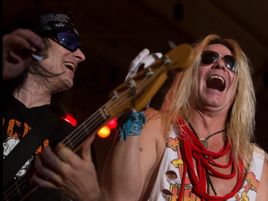 The band Hairball performs to a crowd at the Leach Amphitheater for Waterfest Thursday, August 21, 2014.