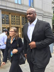 FILE -- In this Oct. 10, 2017 file photo, former Auburn University assistant men's basketball coach, Chuck Person, leaves Manhattan federal court in New York, after an initial appearance before a magistrate judge. Person is scheduled to plead guilty on Tuesday, March 19, 2019 to a conspiracy charge in a scandal that involved bribes paid to families of NBA-bound young athletes to steer them to top schools and favored money managers and agents. (AP Photo/Larry Neumeister, File)