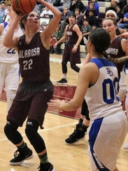 Tularosa's Sierra Montoya, left, tries to score in