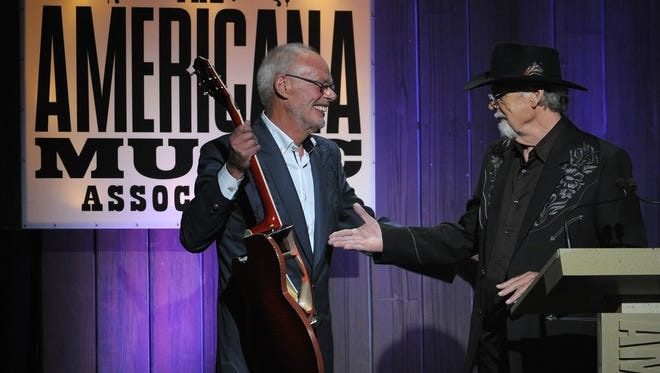 """Bob Harris presents Duane Eddy with a lifetime achievement award during the Americana Honors & Awards at Ryman Auditorium on Sept. 18, 2013, in Nashville. The Country Music Hall of Fame and Museum will honor Eddy on Jan. 23 as part of its """"Nashville Cats"""" series."""