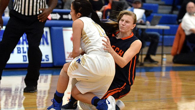 Wilson Central's Piper Elrod collides with Beech's Mia Dean during Saturday's District 9-AAA Tournament semifinals.