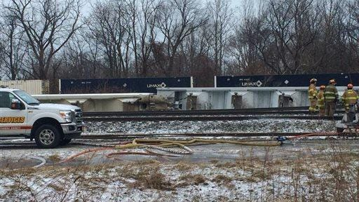 Firefighters work Wednesday at the site of a 16-car Norfolk Southern freight train derailment that forced the evacuation of dozens of western New York homes after ethanol leaked from two tankers in Ripley, N.Y.