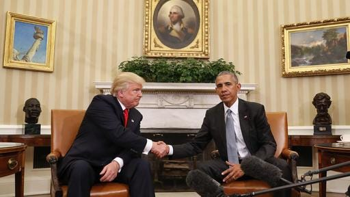 President Barack Obama and President-elect Donald Trump shake hands following their meeting in the Oval Office of the White House in Washington on Thursday.