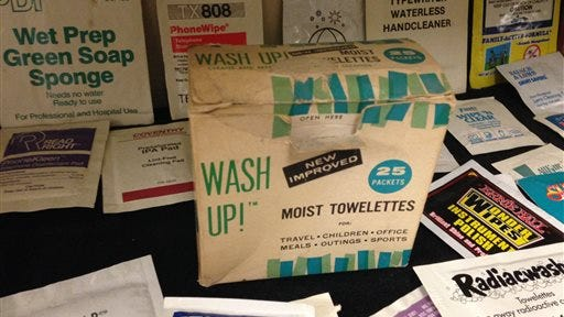 """This Nov. 26, 2014 photo shows a box of """"Wash Up!"""" moist towelettes, the oldest artifact at the Moist Towelette Museum in East Lansing, Mich."""