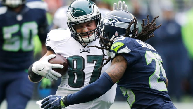 Seattle Seahawks cornerback Richard Sherman, right, moves in to tackle Philadelphia Eagles tight end Brent Celek (87) in the first half of an NFL football game, Sunday, Nov. 20, 2016, in Seattle.