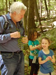 Ed Bieber teaches a group of Nature Place campers about