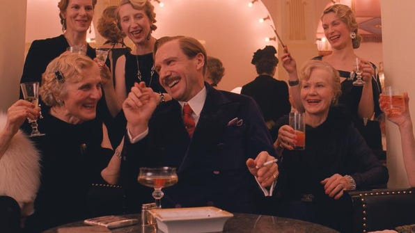 """Ralph Fiennes, center, plays a charming concierge in the sublimely farcical """"The Grand Budapest Hotel."""""""