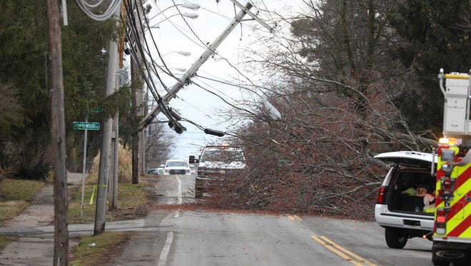 A pole snapped after a tree that had taken down another power line pulled on the lines. A portion of Edgewood Drive in Brighton was closed temporarily.