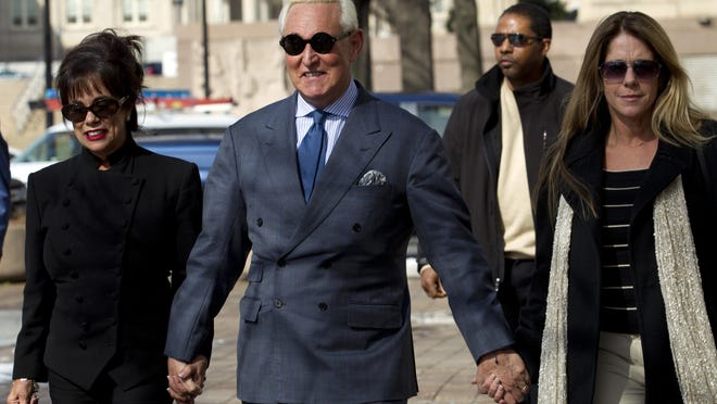 Former campaign adviser for President Donald Trump, Roger Stone accompanied by his wife Nydia Stone, left, and daughter Adria Stone, arrives at federal court in Washington, Thursday, Feb. 21, 2019. Stone was ordered to appear in court over a Instagram post he made about U.S. Judge Amy Berman Jackson.