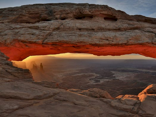 It's a rite of passage, contributor Mark Doiron says, for all visitors to the Mesa Arch in the Canyonlands.