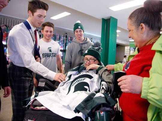Michigan State hockey players from left, Tommy Apap,