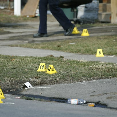 Evidence markers placed at a shooting scene on Fourth