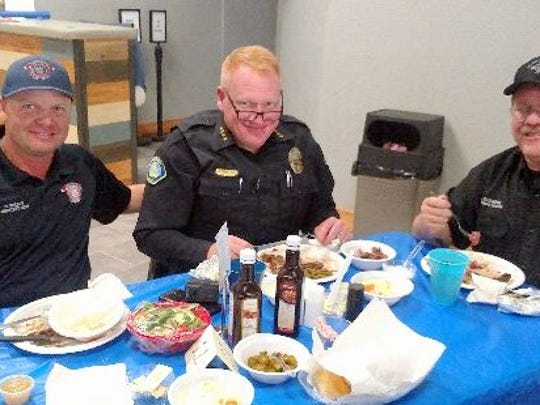 Ruidoso Police Chief Darren Hooker, center, enjoys the steak lunch with Cody Wilson, left, assistant Ruidoso fire chief, and village Emergency Manager Joe Kasuboski.