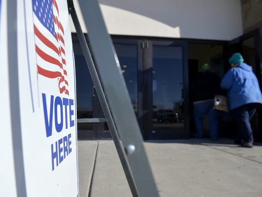 Voters drop off their ballots at Exhibition Hall on