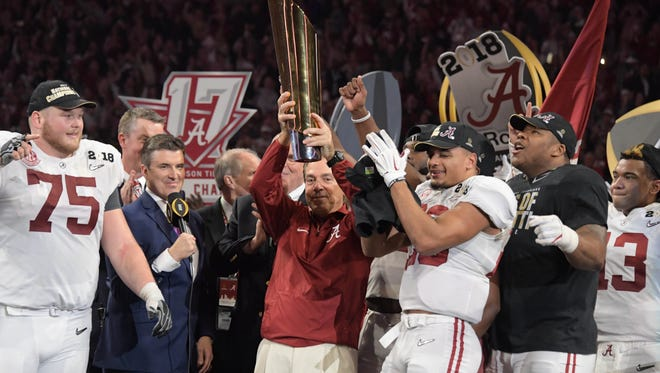 Jan 8, 2018; Atlanta, GA, USA; Alabama Crimson Tide head coach Nick Saban holds up the trophy after the win over the Georgia Bulldogs in the 2018 CFP national championship college football game at Mercedes-Benz Stadium. Mandatory Credit: Kirby Lee-USA TODAY Sports