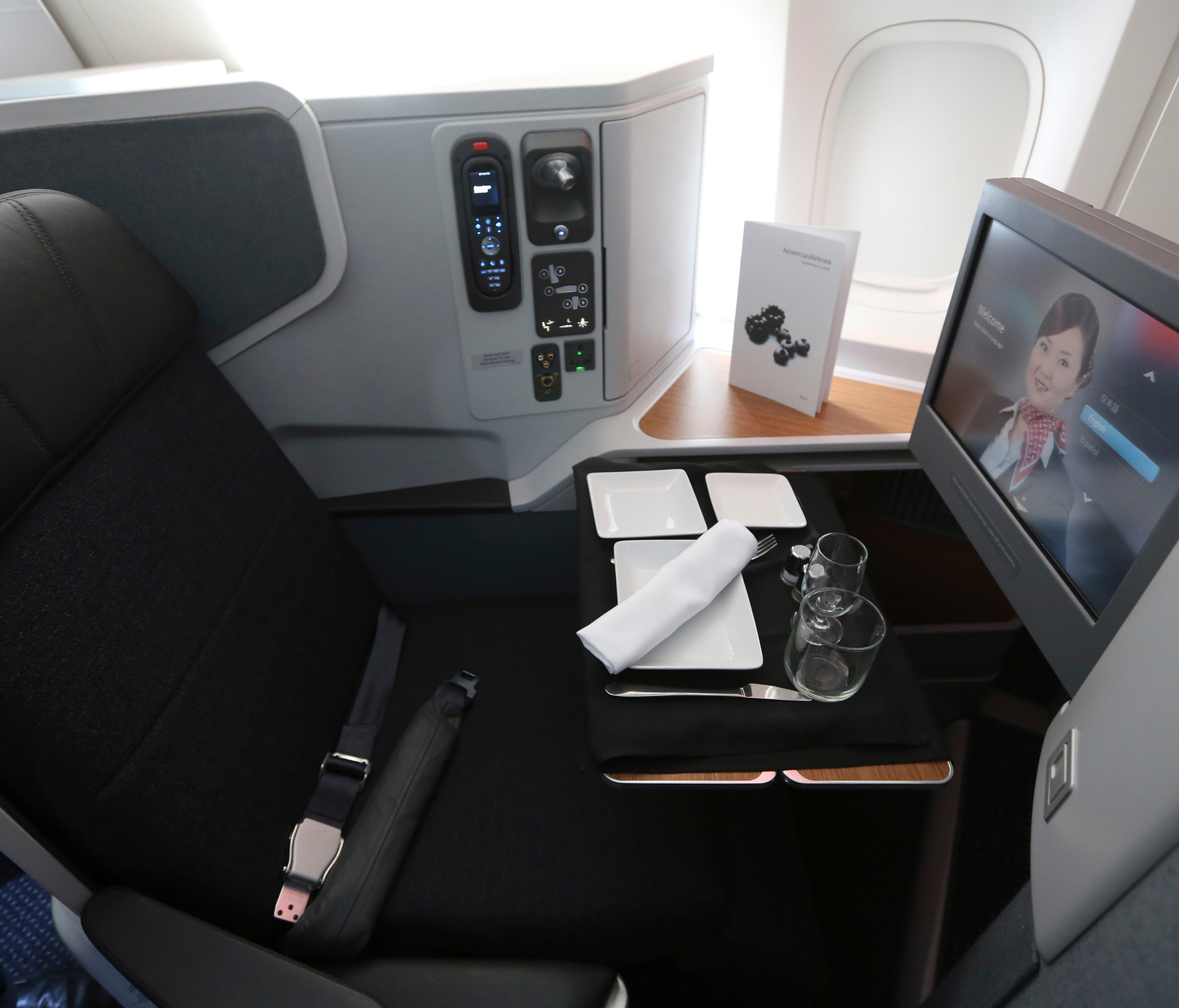 A first-class seat set up for a passenger's meal in American Airlines' Boeing 777-300ER airplane.