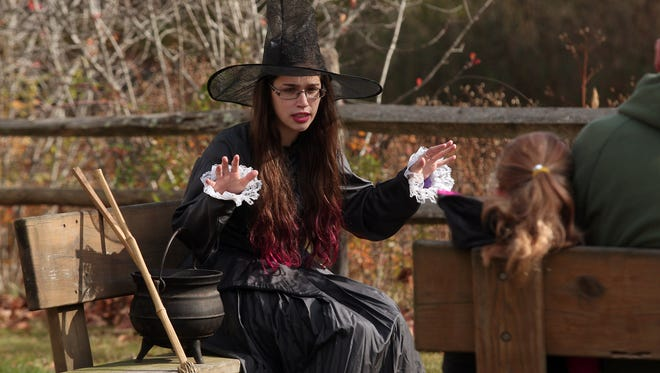 Ashley Scotto, Historic Program Specialist tells terrifying local ghost stories during a Historic Haunting at Historic Speedwell in Morristown. October 31, 2015, Morristown, NJ.
