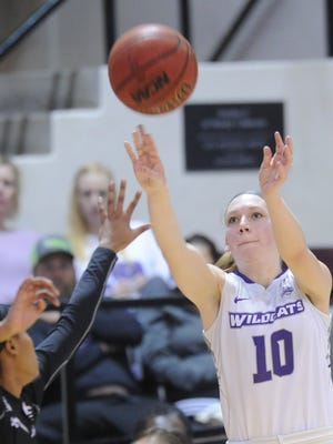 ACU's Breanna Wright, right, passes the ball over a Stephen F. Austin defender in their Southland Conference game Wednesday, Feb. 28, 2018 at Moody Coliseum. SFA won 78-52.