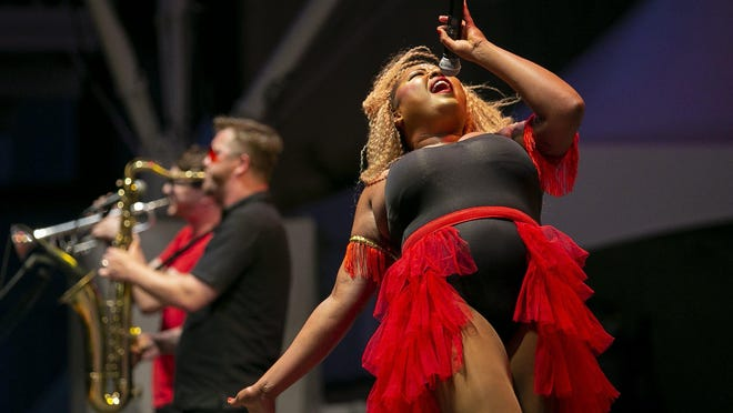 "Seven-piece neo-funk group MojoFlo, with lead singer Amber Knicole, performs in 2019 at the John F. Wolfe Columbus Commons, Downtown. ""I'm really excited for everyone to be around each other,"" she said of this week's drive-in performance scheduled for Westland Mall."