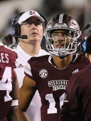 Mississippi State quarterback Keytaon Thompson (10) and coach Joe Moorhead watch the video display board during a timeout during the second half of the team's NCAA college football game against Louisiana Tech on Saturday, Nov. 3, 2018, in Starkville, Miss. MSU won 45-3. (AP Photo/Jim Lytle)