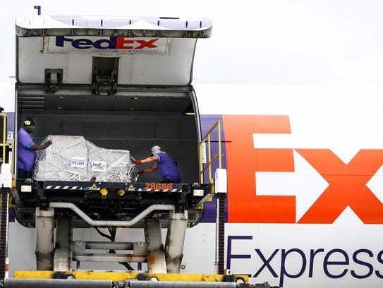 FedEx employees load an A300 Airbus with 20,000 meals