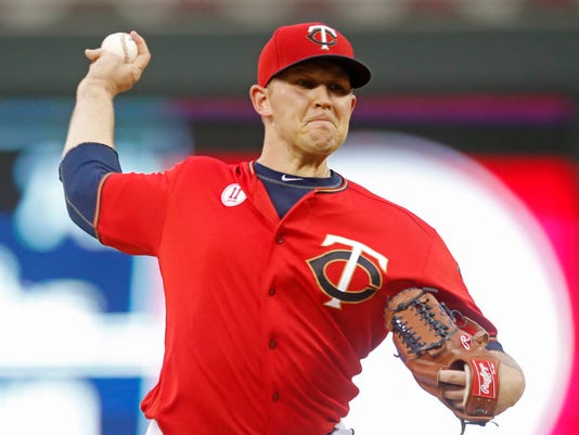 Minnesota Twins pitcher Tyler Duffey throws against the Cleveland Indians during the first inning of a baseball game Friday, Sept. 9, 2016, in Minneapolis. (AP Photo/Jim Mone)
