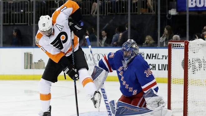 Rangers goalie Henrik Lundqvist (30), of Sweden, stops a shot on goal by Philadelphia Flyers's Wayne Simmonds (17) during the first period of an NHL preseason hockey game Thursday, Oct. 6, 2016, in New York.