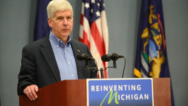 Gov. Rick Snyder speaks to the press on Wednesday, April 20, 2016, regarding the criminal charges against two state workers and a Flint city employee in regards to the Flint water crisis at the George W. Romney Building in Lansing.