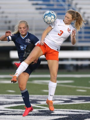 Matti Benson (29) of Louisville goes for a header with Brennan Harder (3) of Hoover during their game at Louisville on Monday, Sept. 21, 2020. Hoover won the game 4-3.