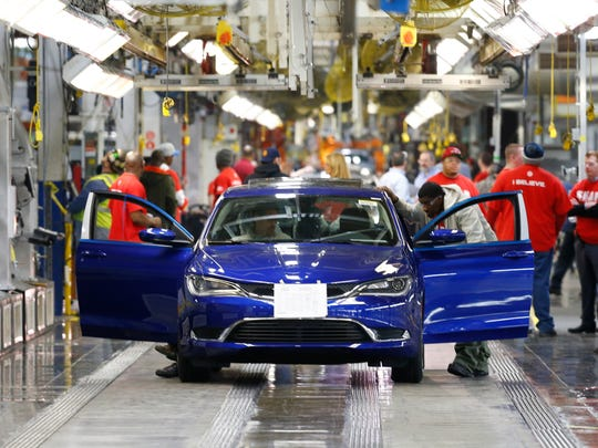 A 2015 Chrysler 200 automobile moves down the assembly line at the Sterling Heights Assembly Plant in Sterling Heights, Mich.