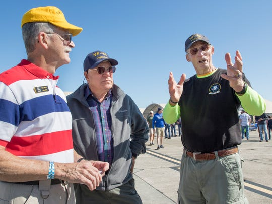 From left, Navy veterans Troy Nicks, Dave Everett and Theodore Triebel talk Saturday, Nov. 11, 2017, about their military service during the Blue Angels Homecoming Air Show at Pensacola Naval Air Station. Everett last saw Triebel and Nicks 45 years ago in the USS Midway aircraft carrier's ready room on the day the two other men were shot down and taken captive in August 1972.