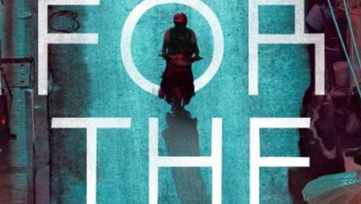 'For the Dead' by Timothy Hallinan.