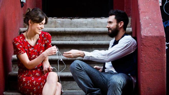 "Keira Knightley and Adam Levine stars in a scene from ""Begin Again."""
