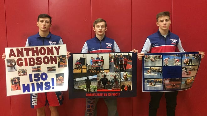 Westland John Glenn senior wrestlers (from left) Anthony Gibson, Mikey Mars and Isaac Lefler have combined to win more than 500 matches during their high school careers.