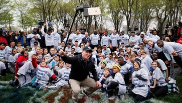 NFL Commissioner Roger Goodell takes selfie with children and draft prospects in Chicago on April 27, 2016.