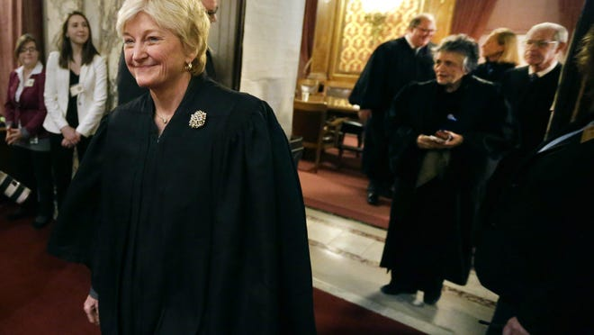 """Wisconsin Supreme Court Chief Justice Patience Roggensack leads the other justices as they enter the Assembly chambers before Gov. Scott Walker delivered his sixth """"state of the state"""" address in 2016 at the state Capitol."""