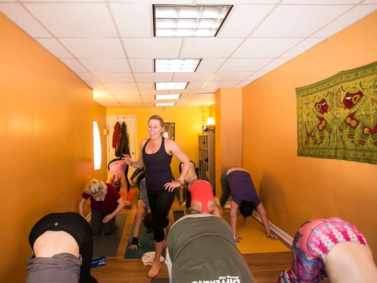 House of Yoga owner Jackie Dahlheimer, instructs a