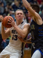 Reitz's Isaiah Dunham (13) goes for a layup as the Reitz Panthers take on the Castle Knights at Reitz High School in Evansville, Ind., on Friday, Dec. 15, 2017.