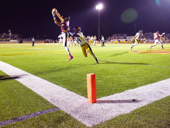 Harrisburg's Brooks Fuller catches a touchdown in the