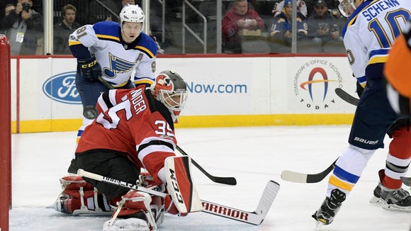New Jersey Devils goalie Cory Schneider (35) deflects