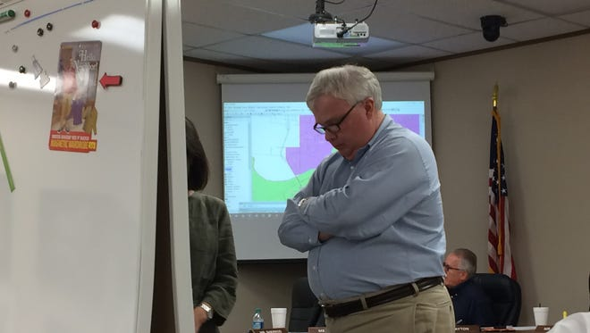 Dale Harvey, Wichita Falls ISD School Board president, looks at an attendance zone map at a June 12 special session.
