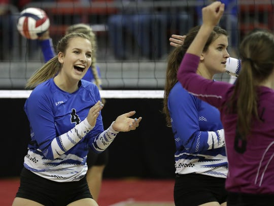 Merrill's Molly Weix celebrates a point against Catholic Memorial in the WIAA state girls volleyball tournament in 2016. Weix is one of six seniors on the Bluejays roster.