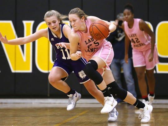 Katie Hill (25) of St. John Vianney dribbles the ball