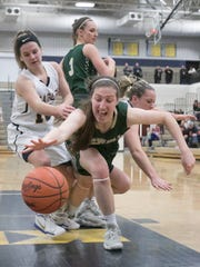 Leah Weslock of Howell fights to regain control of the ball in the game at Hartland Tuesday, Jan. 9, 2018.