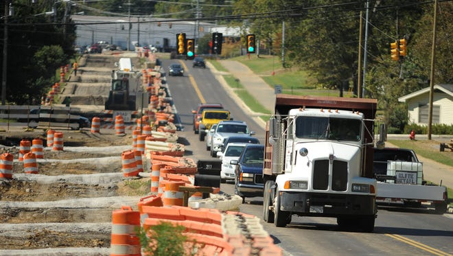 Motorists battle barrels, barricades and construction traffic as they negotiate the construction zone along Lake Harbour Drive in Ridgeland.