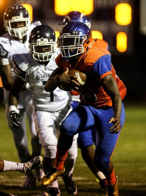 Millville running back Clayton Scott breaks through the line for a positive gain against Atlantic City on Friday.