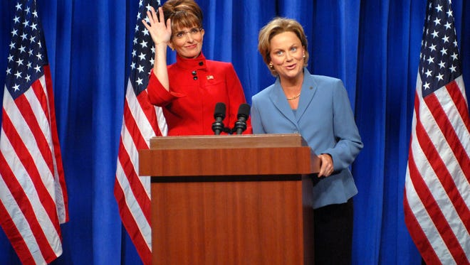 Tina Fey, left, plays Palin, and Amy Poehler plays Hillary Clinton on 'SNL' in September 2008 in New York.