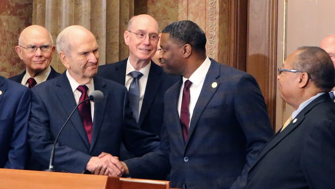 Mormon church President Russell M. Nelson (left) shakes hands with NAACP President Derrick Johnson during a news conference Thursday, May 17, 2018, in Salt Lake City.